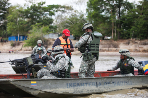 These Colombian Marines are checking if this canoero has his papers in order and also if he carries illegal merchandise.