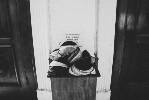 Caps called Kippot are piled up at the entrance of the synagogue.