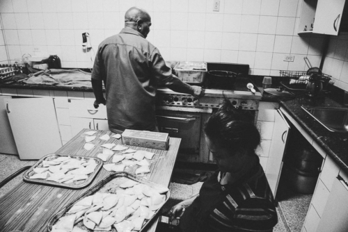 In the kitchen of the synagogue, two employees were preparing traditional potato pierogen filled with cheese and eggplant cream.