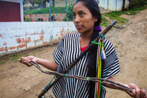 The Nasa have their own autonomous justice system. Vivian Juliet Velasco Paya, the 21-year-old sheriff of Palmera, Colombia, shows a fuete, or whip, used to punish members of the Nasa tribe.