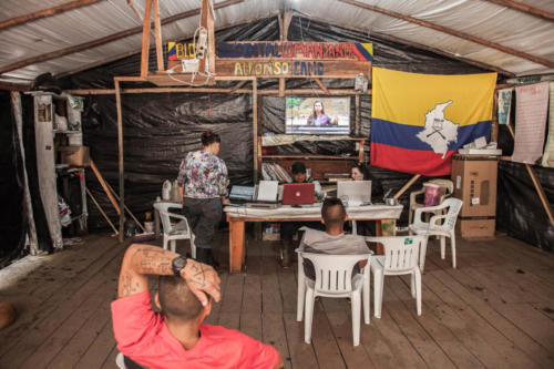 Farc rebels are checking the news in the in the headquarters of the camp stuffed, a camouflaged tent with a television set and computers.